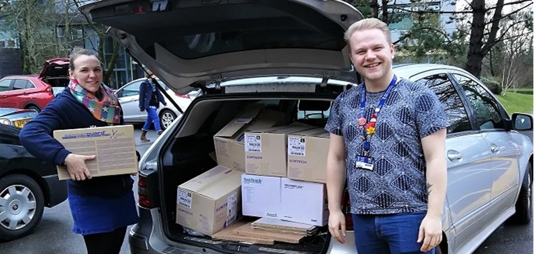 Swansea Uni staff putting boxes into car