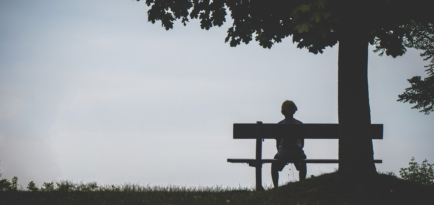 someone sitting alone on bench