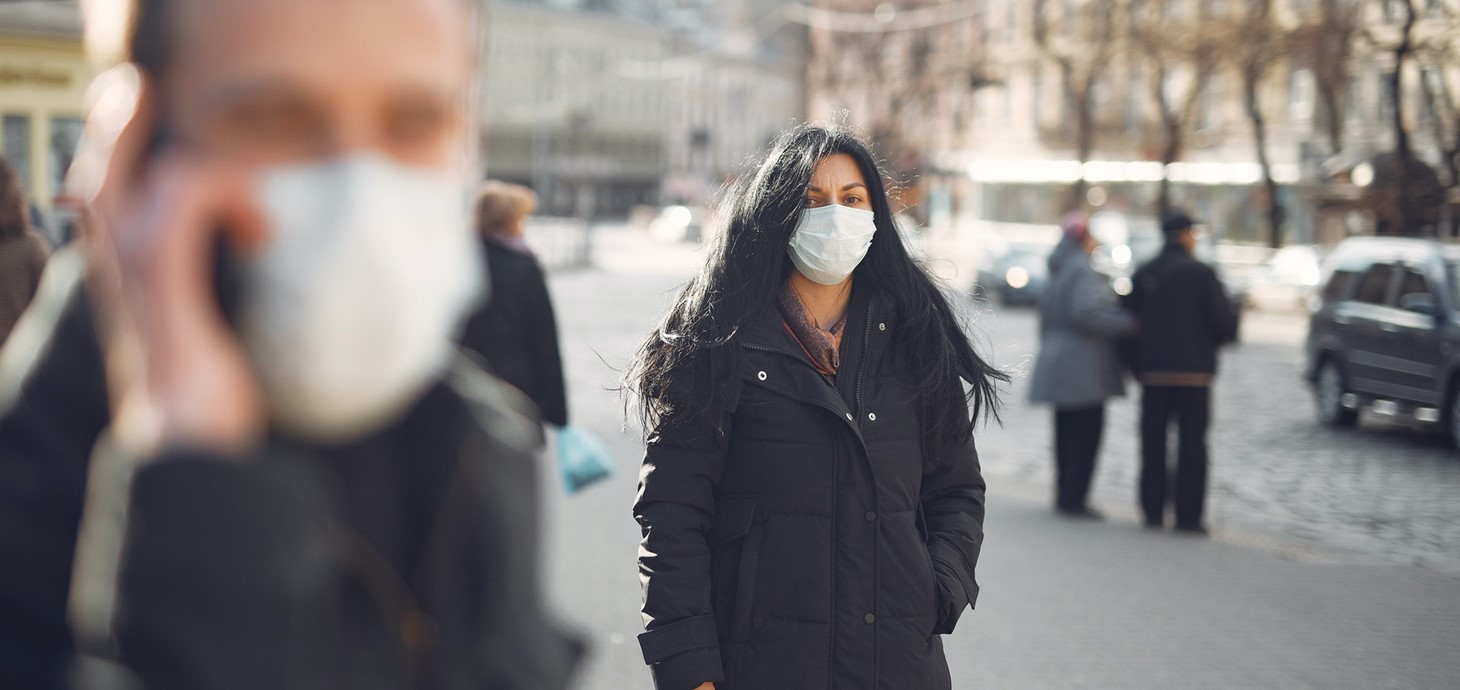 Woman walking with facemask on