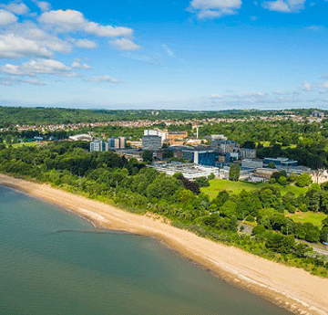 Aerial shot of Singleton Park Campus and the Beach in the glorious sunshine