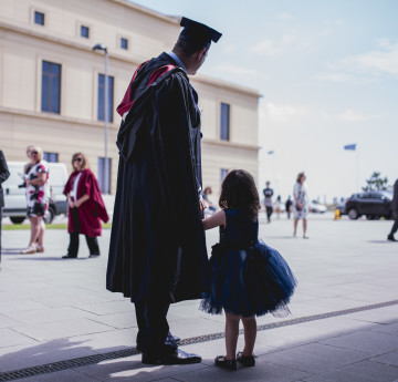 dad with little girl at grad