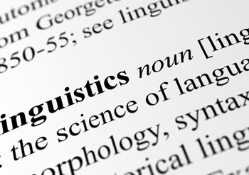 Image of dictionary open to the word 'Linguistics'