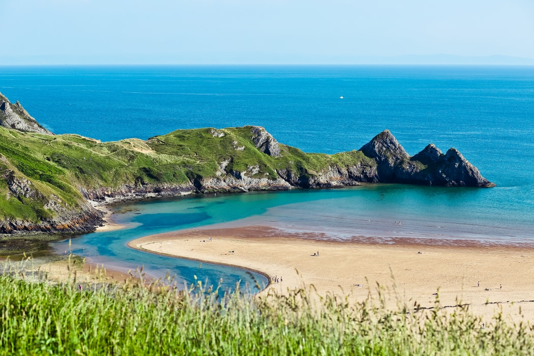 View of Three Cliffs Bay on a sunny day