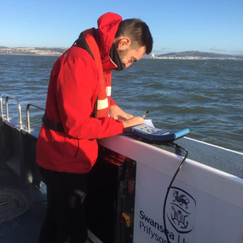 Sam Files collecting data at sea in Mary Anning research vessel