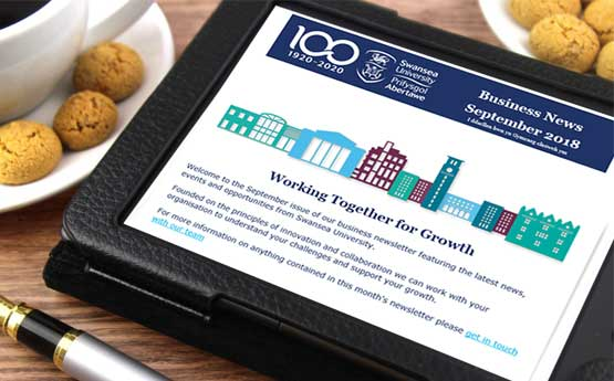 A tablet with the Swansea University newsletter on it