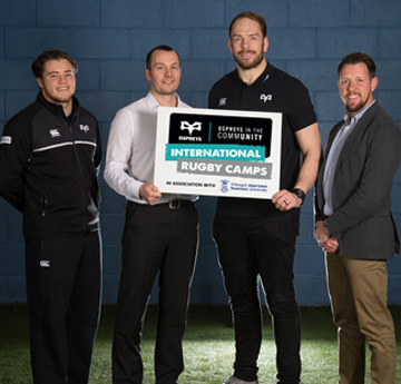 Alun Wyn Jones from the Ospreys rugby team with members of staff from Swansea University