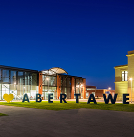 night time bay campus 'love abertawe' sign