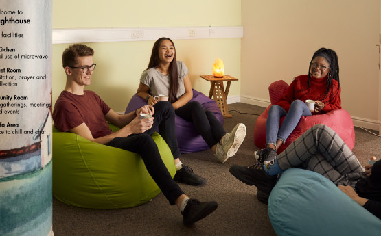 Students sitting in The Lighthouse Quiet Room on bean bags.
