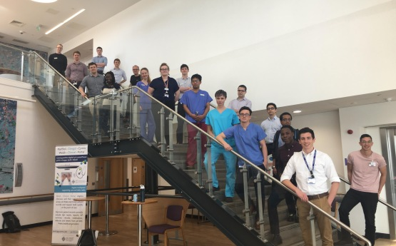 Final year cohort of medical students stood on a staircase.