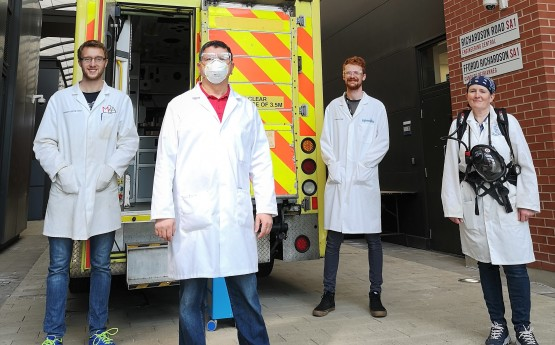 Engineering team with ambulance used to test speed-cleaning procedure.