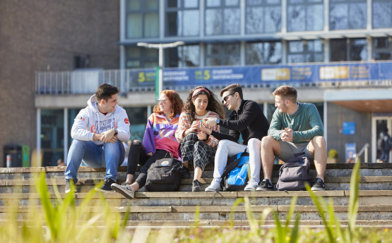 Students sitting outside Fulton House