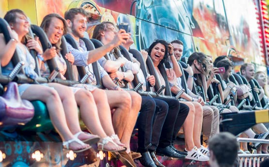 Students on a fairground ride at the summer ball