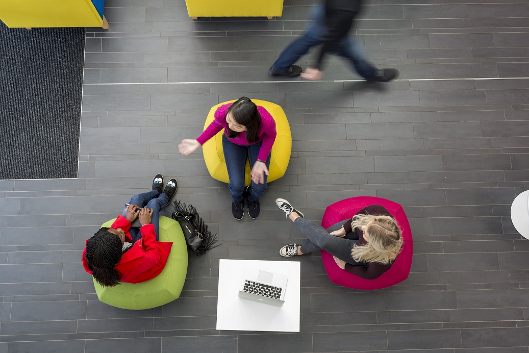 Three students sitting on bean bag
