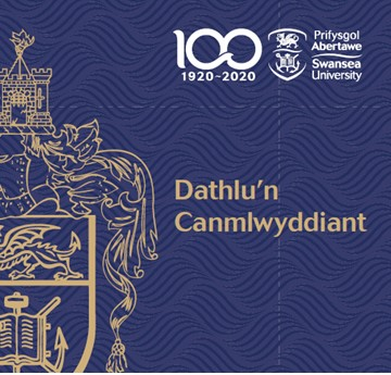 The cover of the Welsh Centenary brochure. Navy with a gold crest and the text