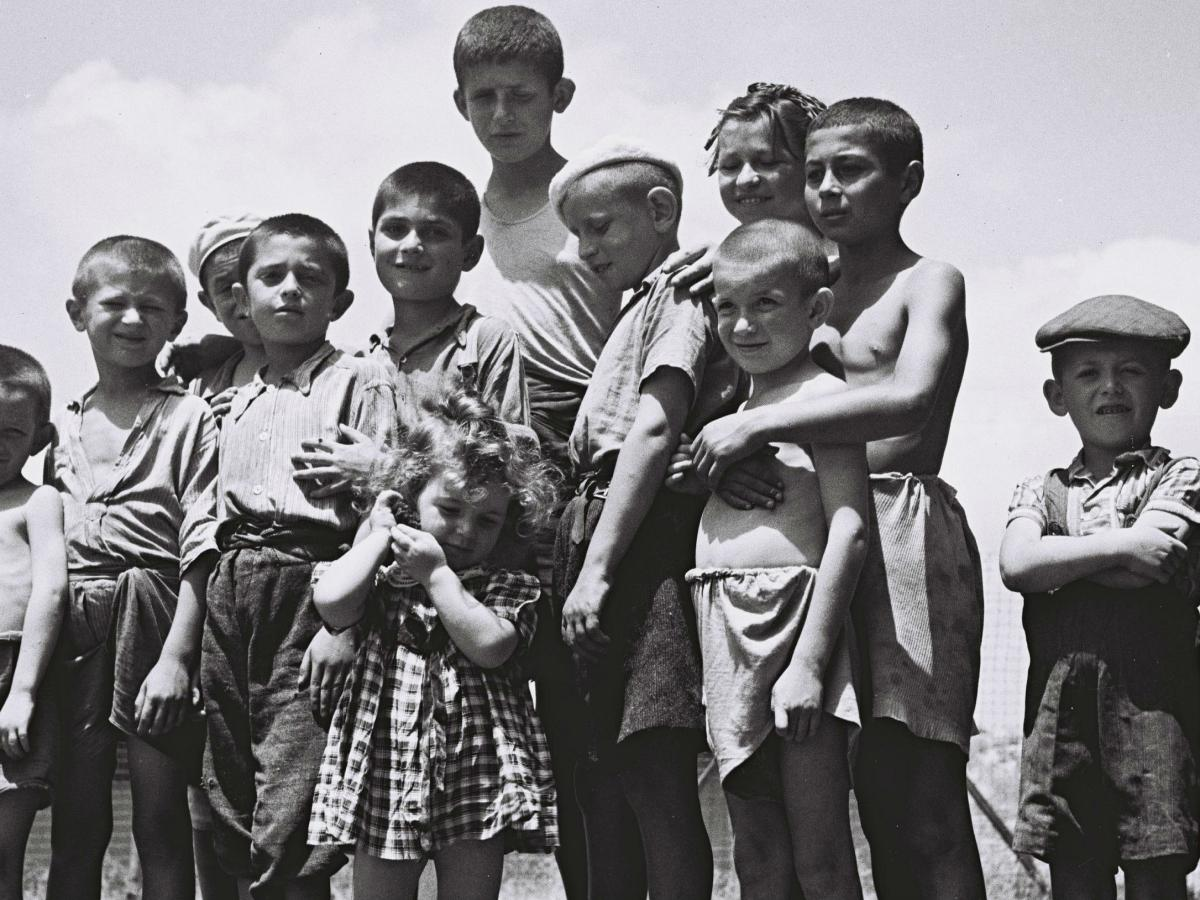 Holocaust Orphans stood in a field.