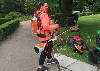 A Swansea University grounds volunteer learning to use the equipment