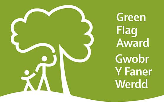 Green Flag Award - a white tree icon with adult and child standing underneath it on a green background