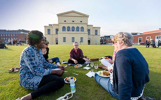 Picnicking on the lawn behind the Great Hall during the British Gerontology Conference