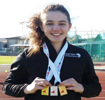Rhian Evans celebrating with her medals