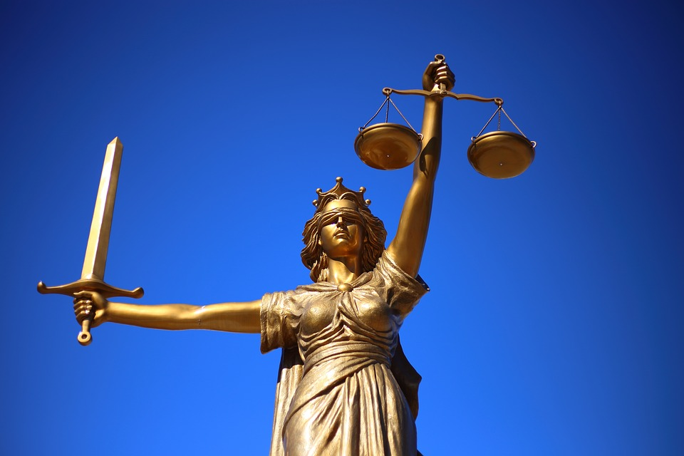 A Photo of lady justice holding the scales of justice