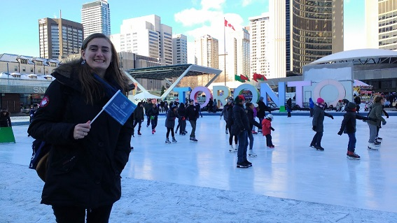Student with flag ice skating