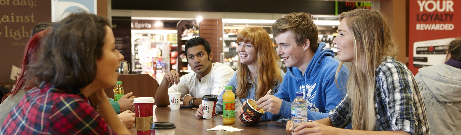 Students chatting in Café Blas over coffee