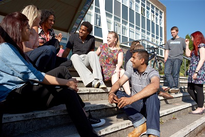 Students chatting on the steps of Grove building