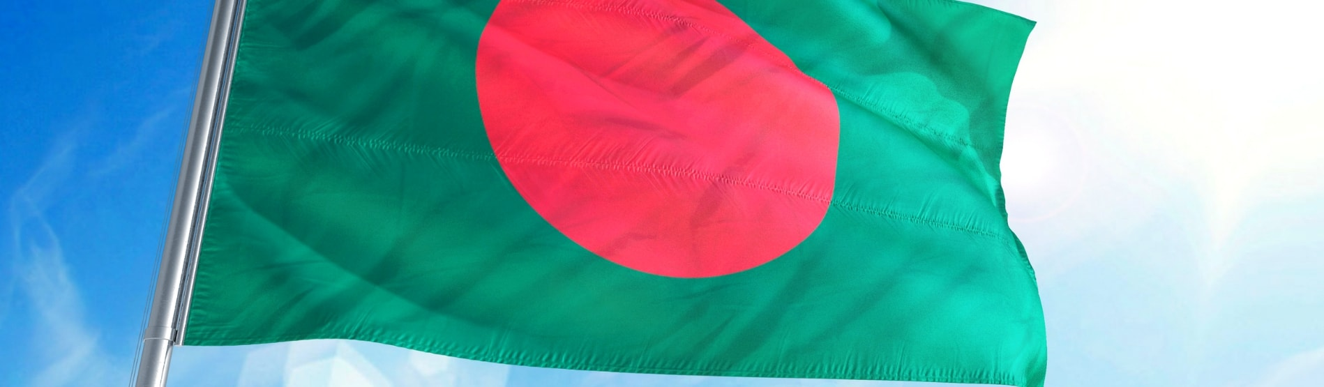 The flag of Bangladesh waving in the breeze.