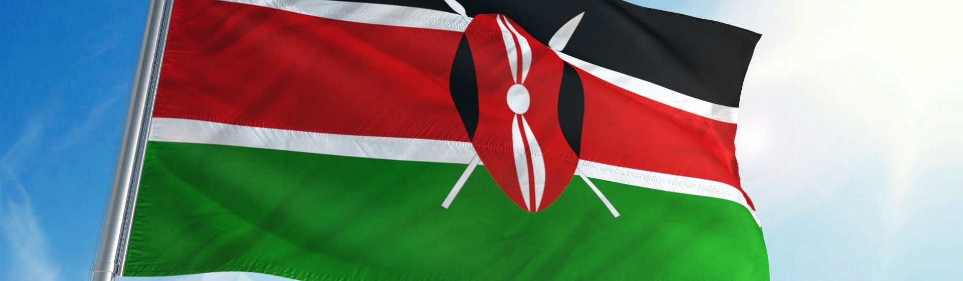 Kenyan flag blowing in the breeze.