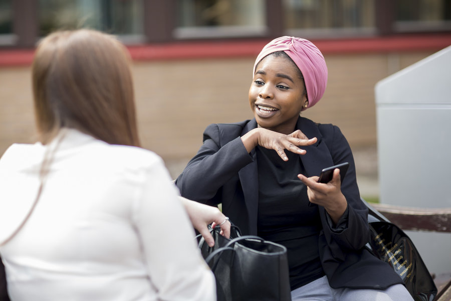 Image of two students talking.