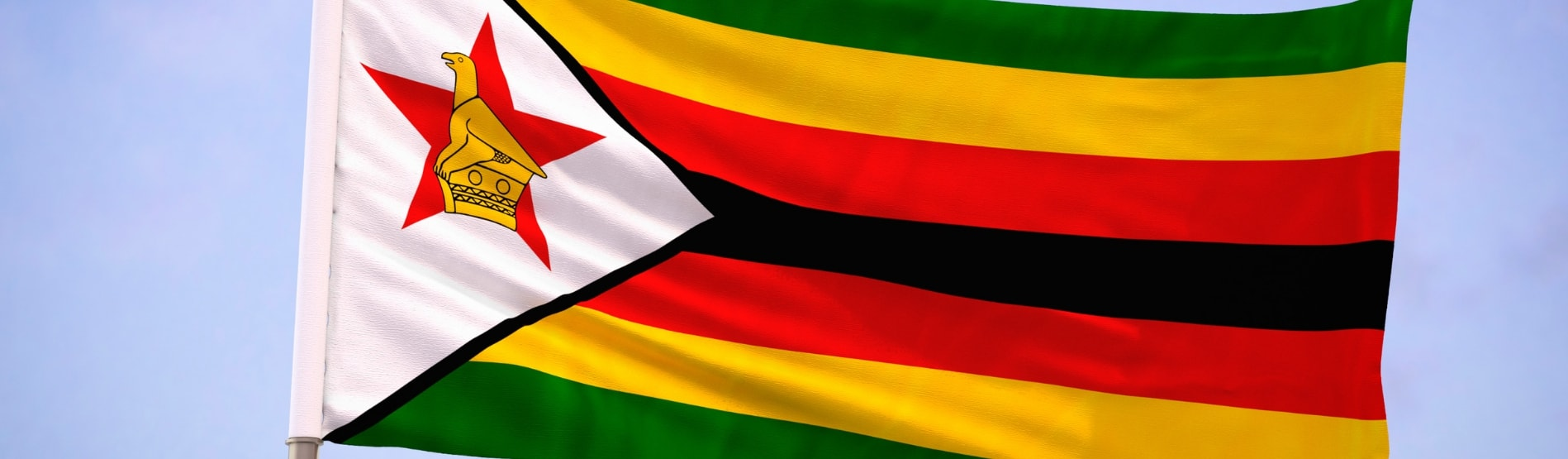Zimbabwe flag blowing in the breeze.