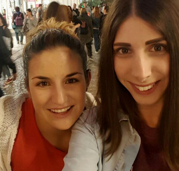 Image of student Eleni and her friend smiling into the camera