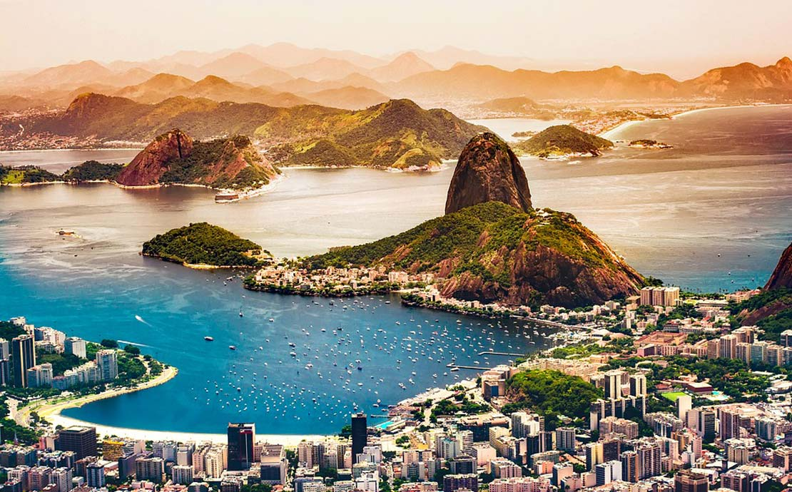 a panoramic view of rio de janeiro in brazil, looking down at the beach and bright blue sea