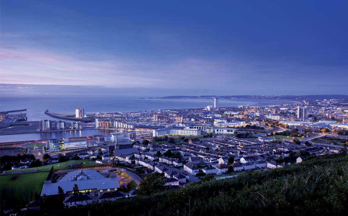 a panoramic view of swansea bay at dusk