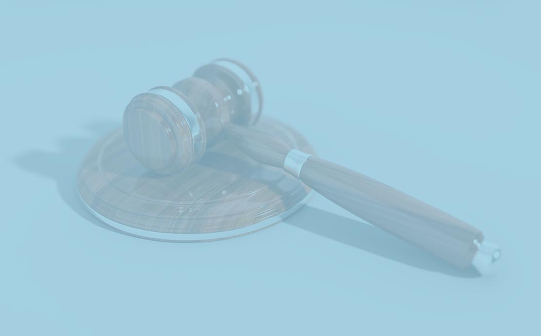 a gavel on a blue background
