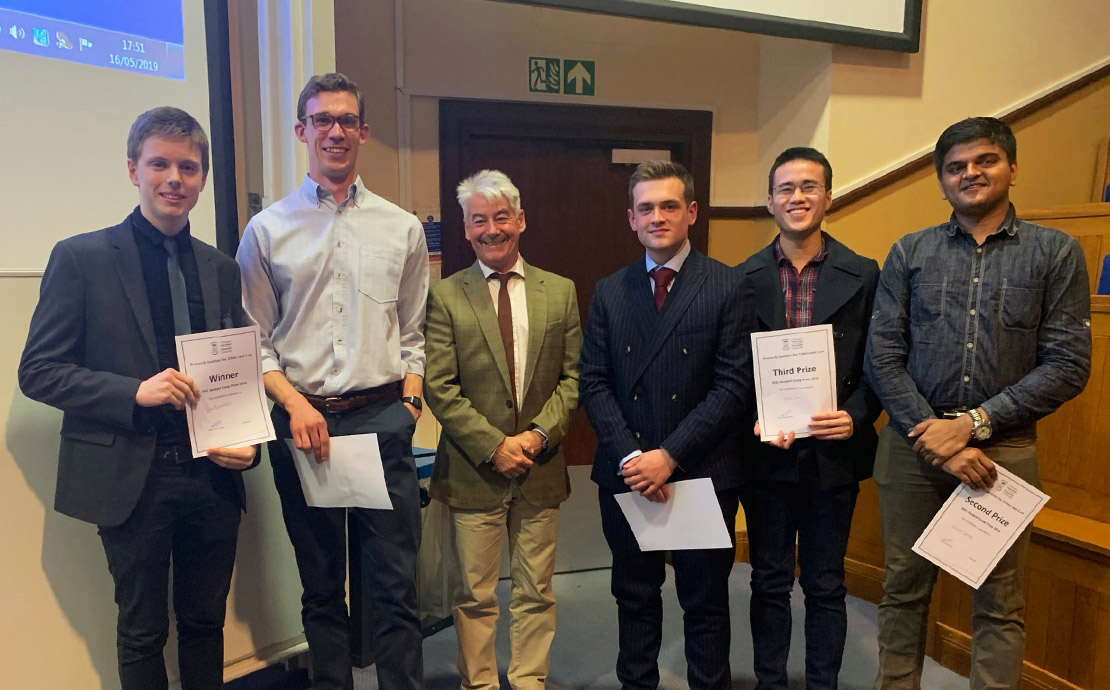 Law student Callum Reid-Hutchings and the other finalists of the RIEL Essay Prize