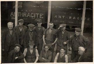 Photograph of colliery tram and workers
