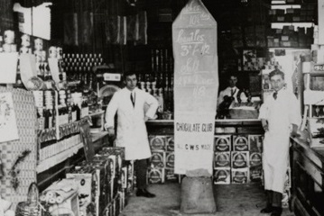 Photograph of interior of co-opertive shop with advert for chocolate club
