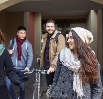 Students chatting walking through Singleton Campus.