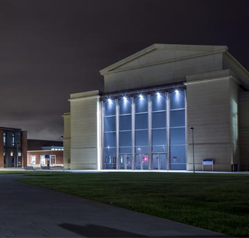 The Great Hall at Bay Campus, lit up at night.