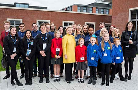 Hillary Clinton at the Bay Campus with a group of school children