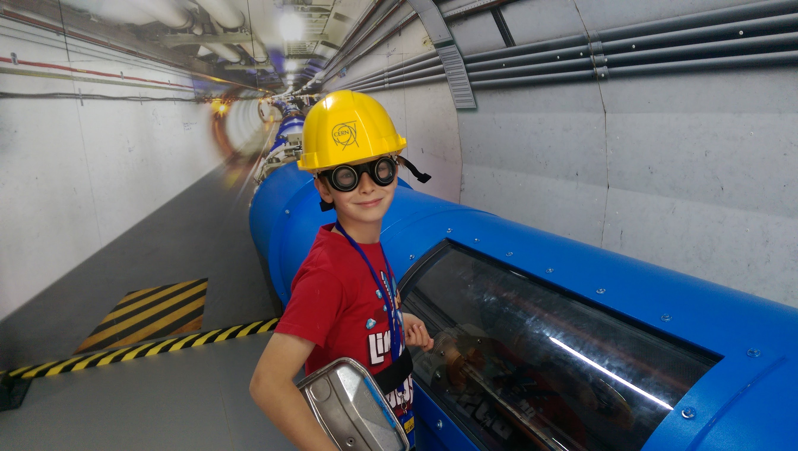 Swansea's Oriel Science centre. Child with model of CERN's Large Hadron Collider