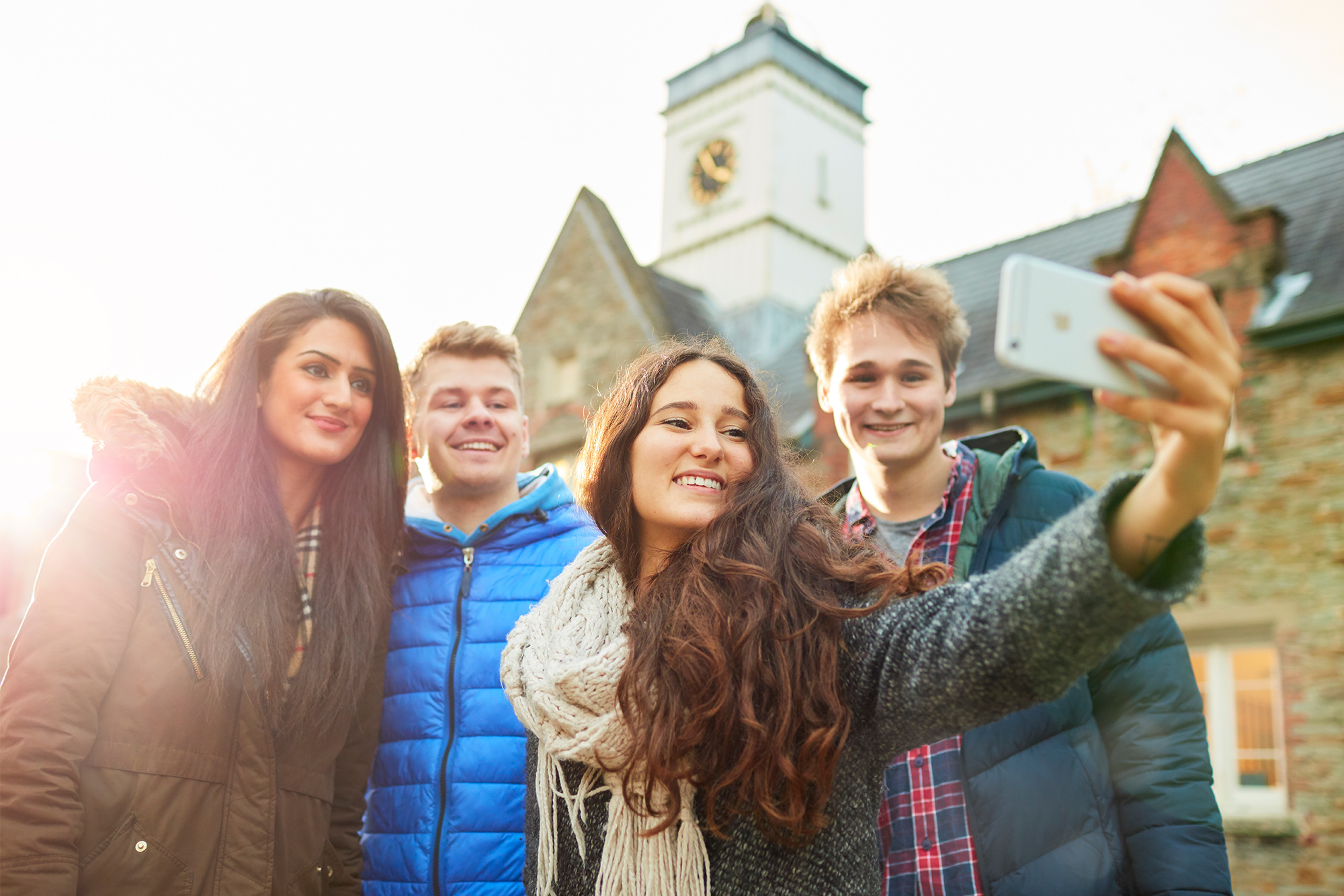 Swansea University students smiling and taking a selfie