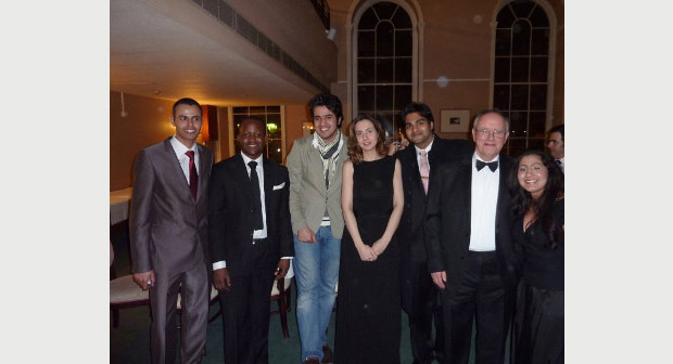 LLM students with Professor Thomas and Dr Nikaki at the end of the year party