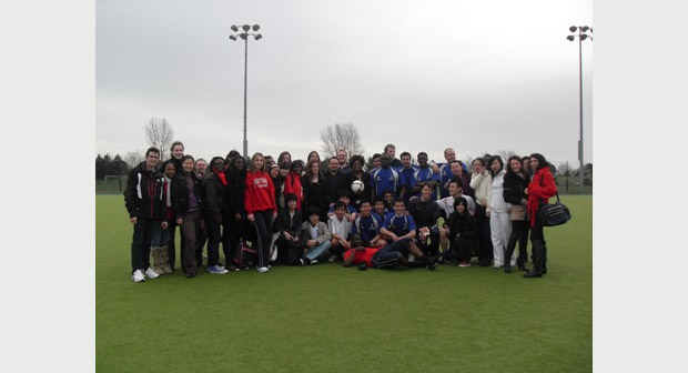 The Football team surrounded by members of the teaching team and LLM students af