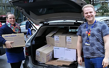 Lecturers Dr Nia Davies and Dr Aidan Seeley loading their car with donations of Medical Supplies