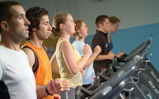Students hitting the Gym on running machines
