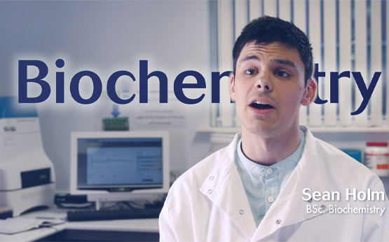 Biochemistry Student Sean Holm course video holding card.
