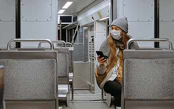 woman on train with mask on