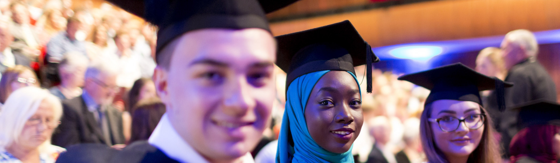Group of male and female graduates smiling